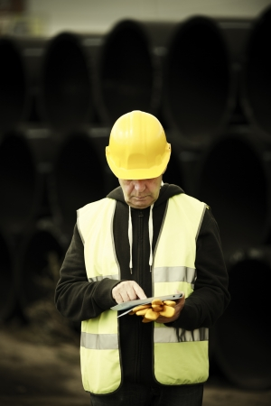 builder with small computer and gloves, selective focus on face Standard-Bild