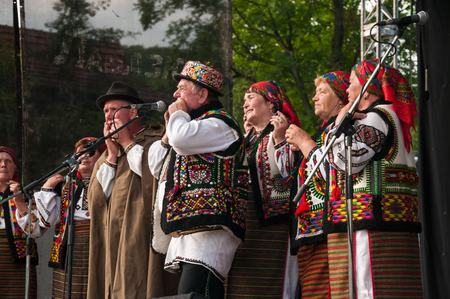 International folk festival Carpathian range in the village of Sheshory in the mountains of the Carpathians, summer, 2016. Ukraine, Europe. Hutsuly in folk costumes.