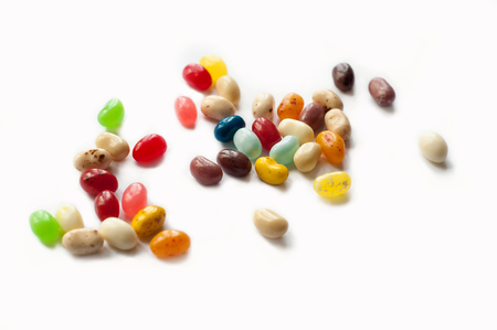 Brightly colored candy beans. Colorful jelly bean background. Jelly beans isolated on white background.