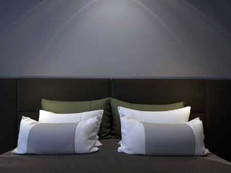 headboard: a modern bedroom with a double bed, headboard and green pillows