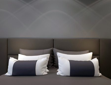 A modern bedroom with a double bed headboard and pillows stock