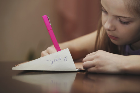 letter envelope: A girl writes a letter to the desire