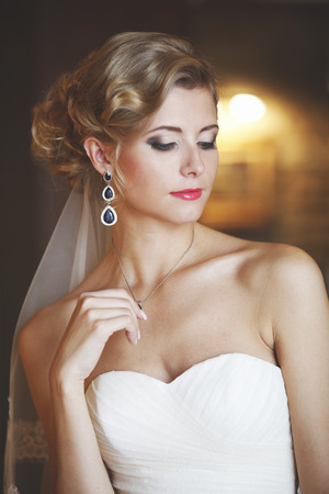 hair dress: Portrait of a woman in a white dress on her wedding day