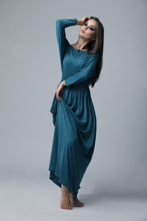 Model in long green dress in the Studio photo