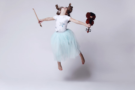 Baby girl with violin on white background