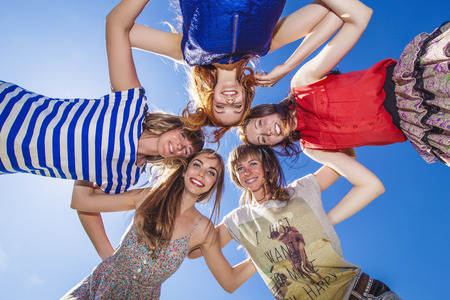 huddle: Women girlfriend happy laugh against the sky