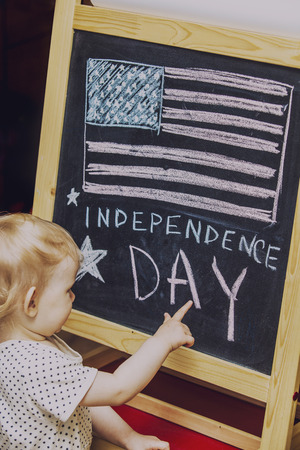 Figure child symbol of the independence day of America on the black drawing Board 写真素材