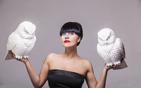 female animal: Model woman with two decorative white owl on hand