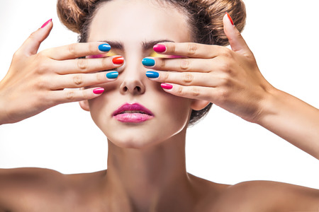 nail color: Model, a woman with bright makeup and bright nail Polish on a white background. Studio, beauty, luster, varnish.