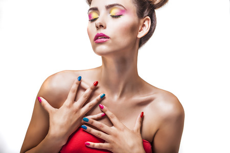 luster: Model, a woman with bright makeup and bright nail Polish on a white background. Studio, beauty, luster, varnish.