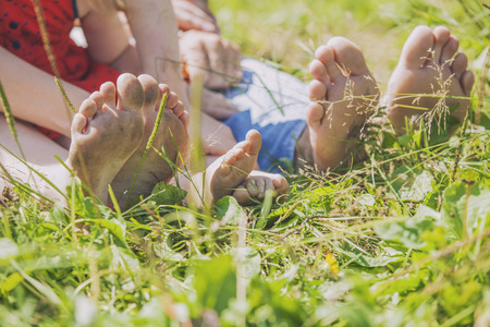 lovers park: Family, mom, dad and child on the nature of the toe, heel. The rest, values, children, love, beauty, summer, Sunny Stock Photo