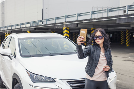 car model: Beautiful woman model selfie in front of his car on the Parking