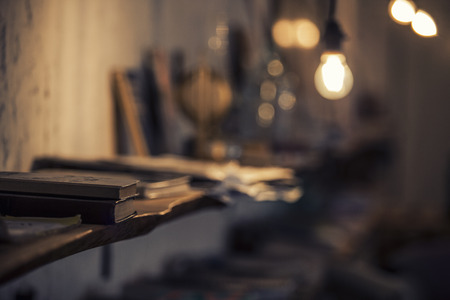 Abstract background with a lamp and book shelves as the main idea with a small depth of field