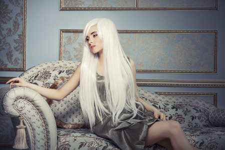 Beautiful woman model with long platinum white hair against magnificent interior