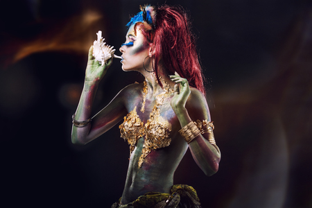 Beautiful young girl with body art in an unusual fantasy style 写真素材