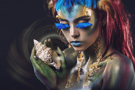 Beautiful young girl with body art in an unusual fantasy style Standard-Bild