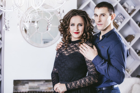 classy house: Couple man and woman beautiful and happy and in a festive modern home interior fashion
