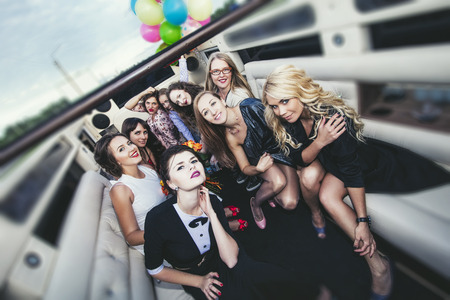Young beautiful happy women celebrate bachelorette party in a convertible limousine Reklamní fotografie - 81810855
