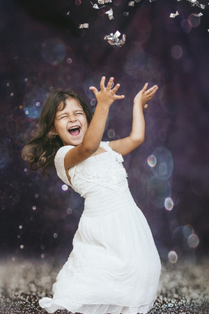 Little girl child cute and beautiful background glare happy happy with confetti Reklamní fotografie - 84589525