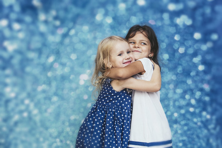 Two little girls child fashion on a background with highlights cute and beautiful Stok Fotoğraf