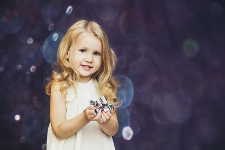 Little girl child cute and beautiful background glare happy happy with confetti Reklamní fotografie - 93199508