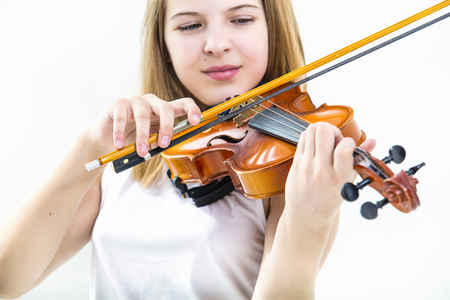 Child girl playing violin learn beautiful and happy in white background Standard-Bild
