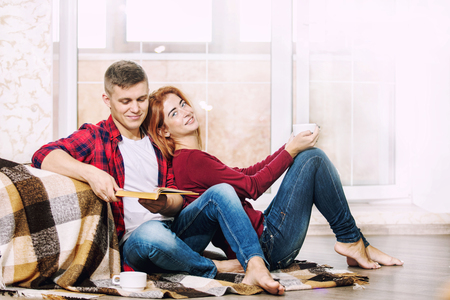 Young adult beautiful couple in love man and woman together at home happy and beautiful Stock Photo