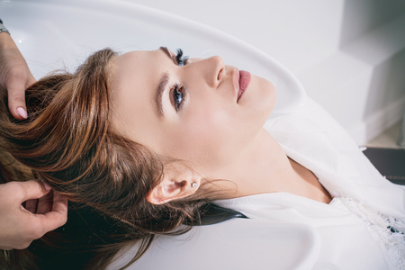 Young beautiful woman client doing hair washing at a professional hairdresser in a beauty salon close-up Фото со стока - 108661608