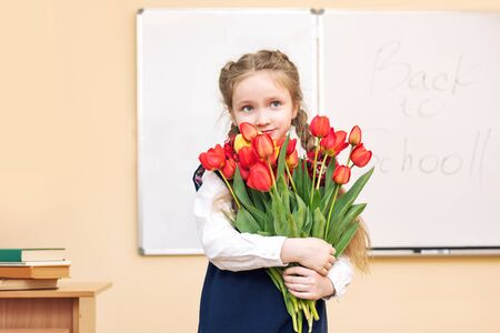Beautiful girl baby the girl happy with a smile in the classroom with the flowers