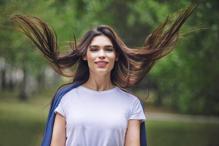 Young adult beautiful brunette girl in casual clothes happy portrait in the Park
