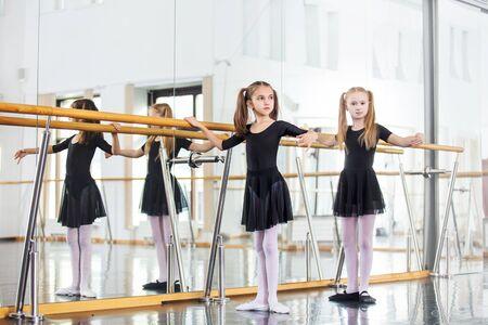 Small beautiful cute girls children in the Studio train at a dance lesson. Zdjęcie Seryjne