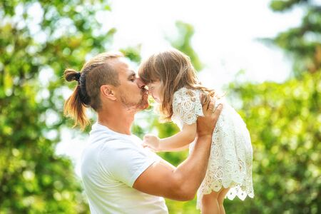 Happy beautiful family together father and daughter portrait on a walk on a Sunny summer day