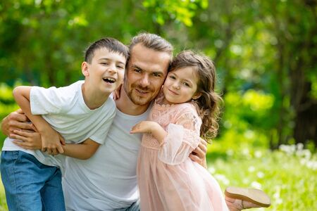 Happy beautiful family together father, son and daughter portrait on a walk on a Sunny summer day 版權商用圖片