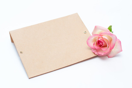 pink rose and envelope on a white background, an envelope for the inscription. Place for inscription