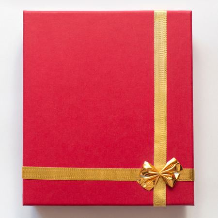 red gift box on white background. Beautiful packaging. A gift to a girl, a woman. For you