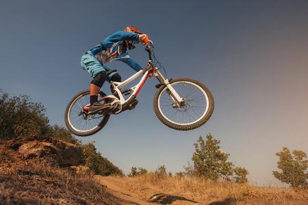 Mountain Bike cyclist jumping. Downhill biking. Extreme sports cycling.