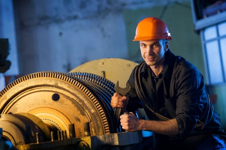 Portrait of a worker repairs powerful steam turbine. Work Industry Stock Photo