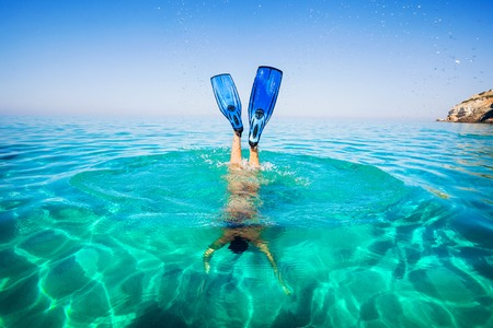 Women snorkeling in clear water on the beach Islands. Girl dives under the sea. Stock Photo