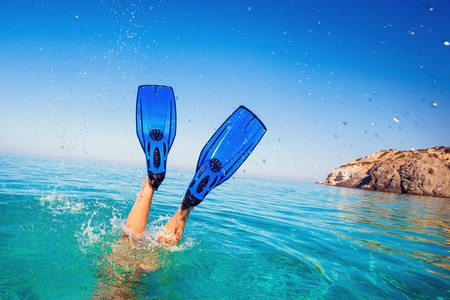 Flippers in water. Diver fins. Active vacation at sea. Diving. Stock Photo