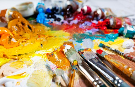 paint palette: oil paints and paint brushes on a palette