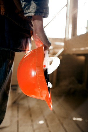 safety wear: Worker holding a helmet in hands.