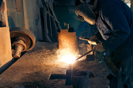 steel works: Welding steel. Welder worker works.