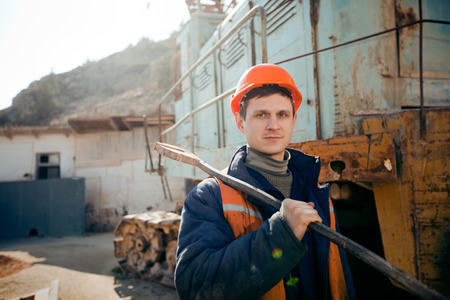 Portrait  worker mine in helmet. Mechanic. Stock Photo