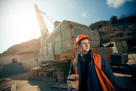 Portrait worker man in helmet on mine career.