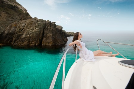 Woman enjoying a yacht at sea on the islands.