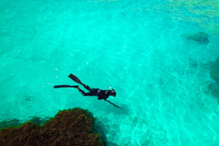 man in a diving suit swims in the sea, top view. Activities on the water