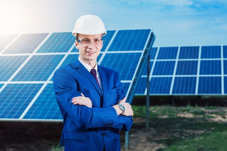 Solar energy. Young business man in a suit near the solar panels to power plants. Stock Photo