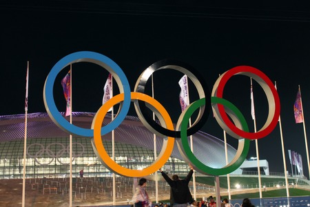 olympic symbol: SOCHI, RUSSIA - FEBRUARY 9, 2014: Olympic rings against the background of The Bolshoy Ice Dome in the Olympic Park of the XXII Olympic Winter Games on February 9, 2014 in Sochi.