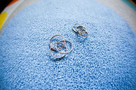 blue carpet: wedding wedding rings on a blue carpet Stock Photo