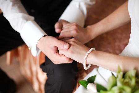 cuff bracelet: Groom in white shirt and bride holding hands 1 Stock Photo
